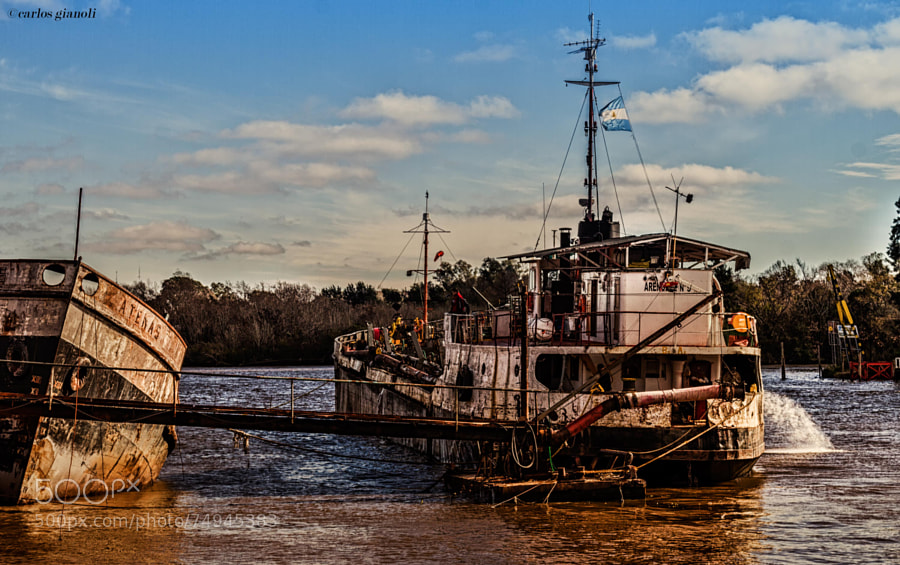 Arenera boat working on the river.