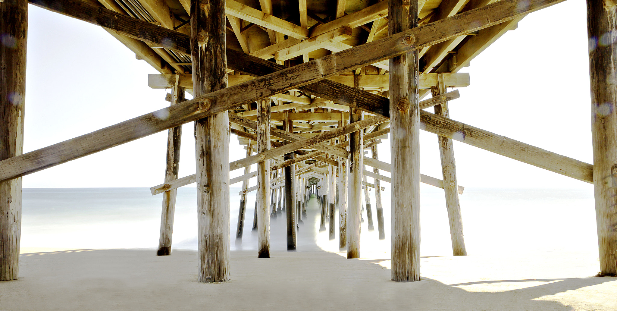 Photograph Under the Pier by Justin Swindle on 500px