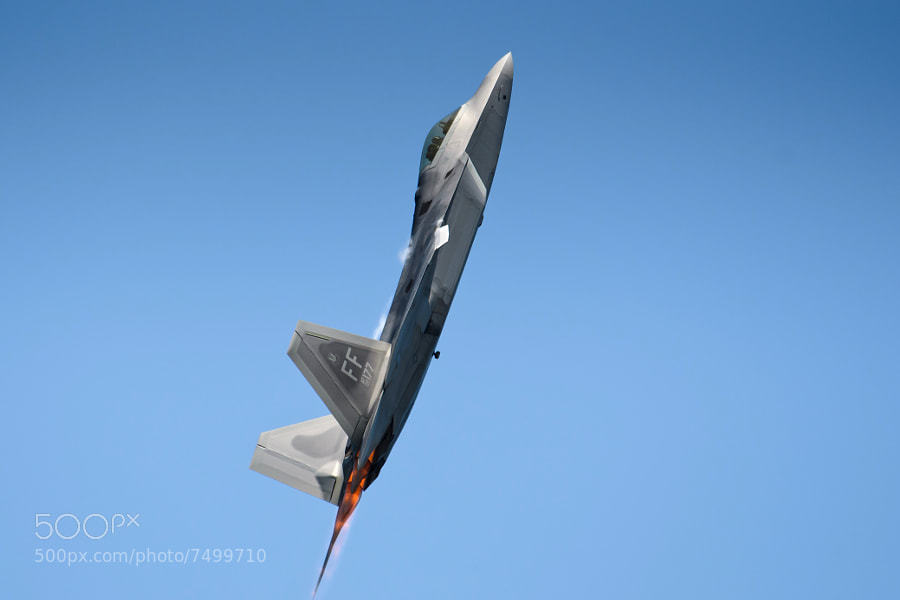 F-22A Raptor uses full afterburner to climb into crystal clear skies over Robins AFB