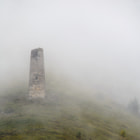 Постер, плакат: Defensive tower in the fog Caucasus alpine zone