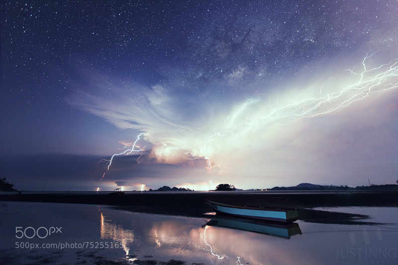 Photograph Rising Milky Way above spectacular lightning show by Justin Ng on 500px