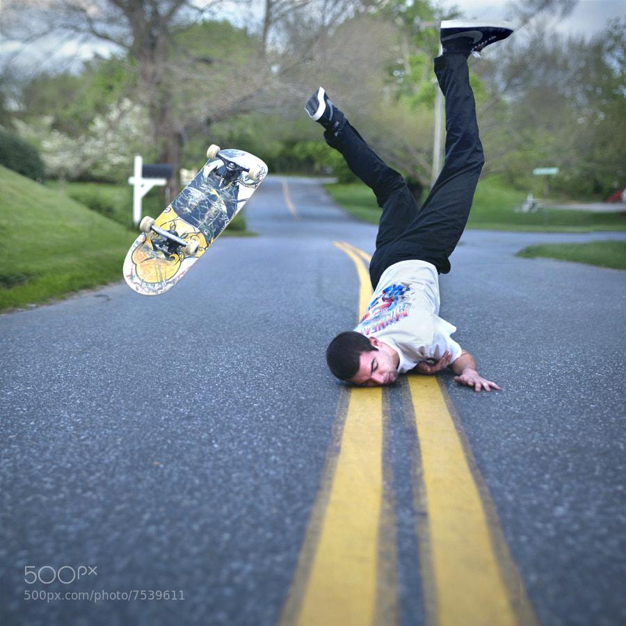 man falling down from skateboard