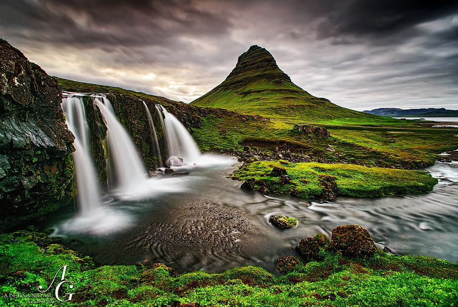Around 1 hour at 'night' clouds travel above the Kirkjufell mountain in the Icelandic peninsula Snæfellsnes