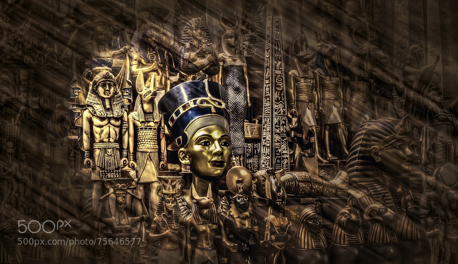 statue of Nefertiti in khan elkhalili between other Pharaonic statues on shelves