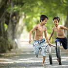 Постер, плакат: Two Boys Play With Two Toys