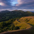 Warm sun lights up British Camp on the Malvern Hills.