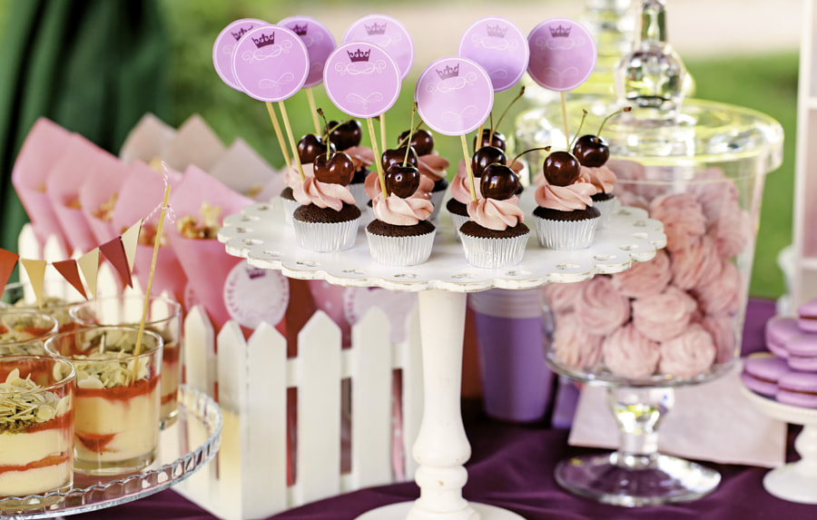 Sweet holiday buffet with cupcakes and tiramisu glasses by Lena Serditova on 500px.com