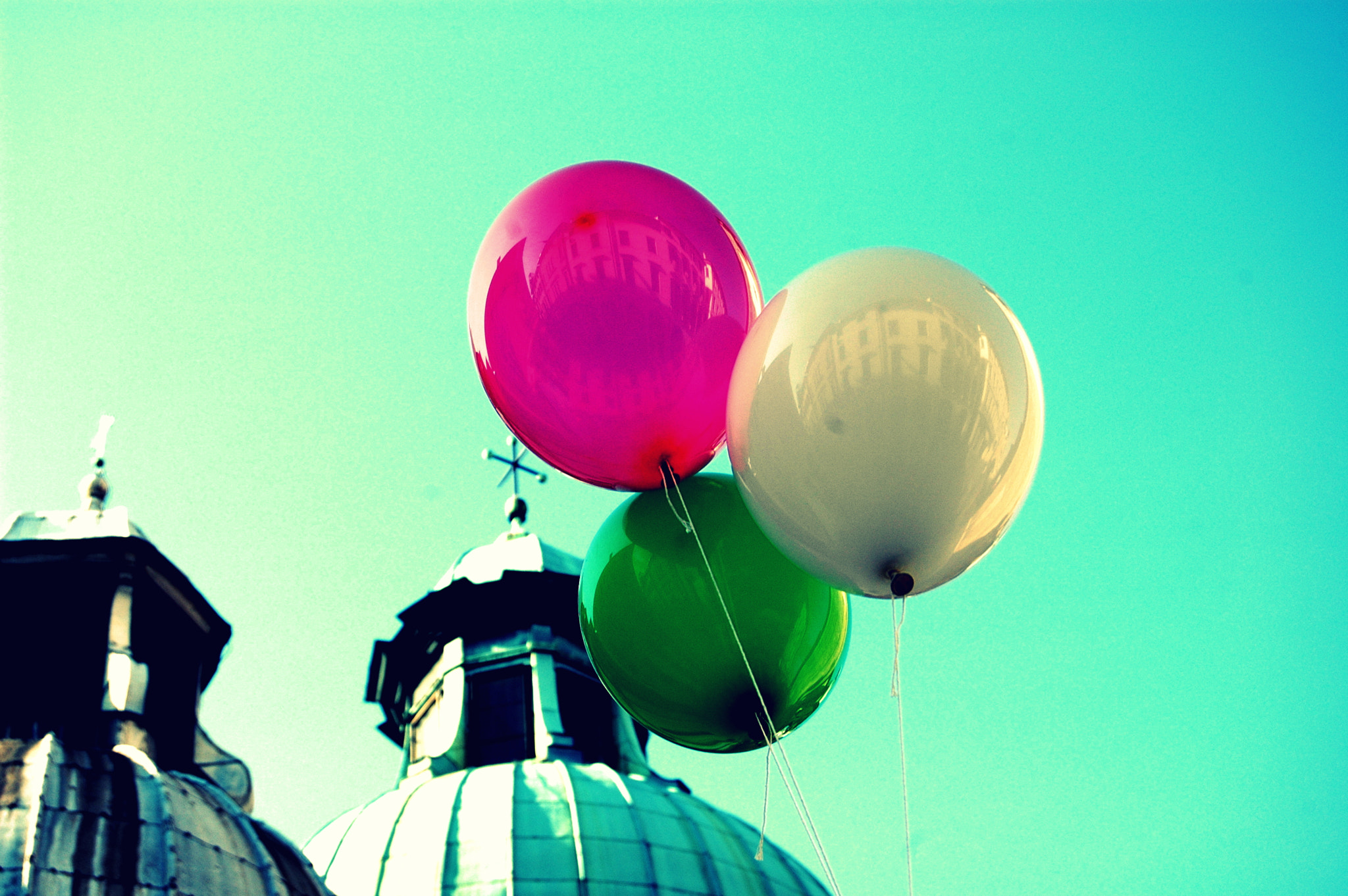 Photograph Coloured balloons in the blue sky by Sushila C. on 500px