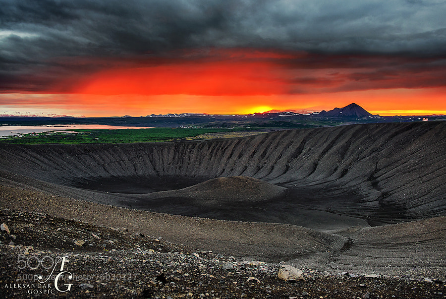 Around half past midnight on the top of the Hverfjall volcano crater, low sun somewhere over the Arctic Ocean found the way under the clouds of northern Iceland near Lake Myvatn, formed after a major eruption 2300 years ago