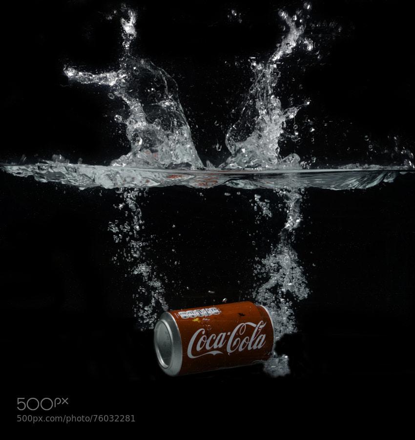 Coca Cola falls into the splash