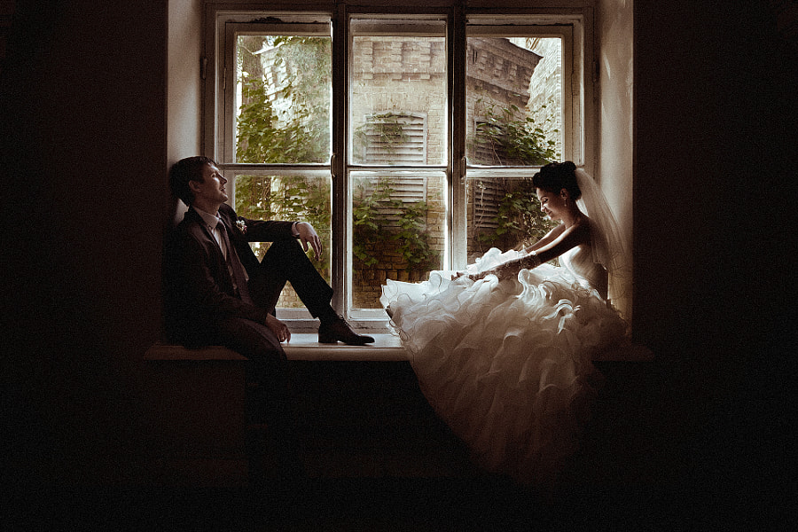 newlyweds at window