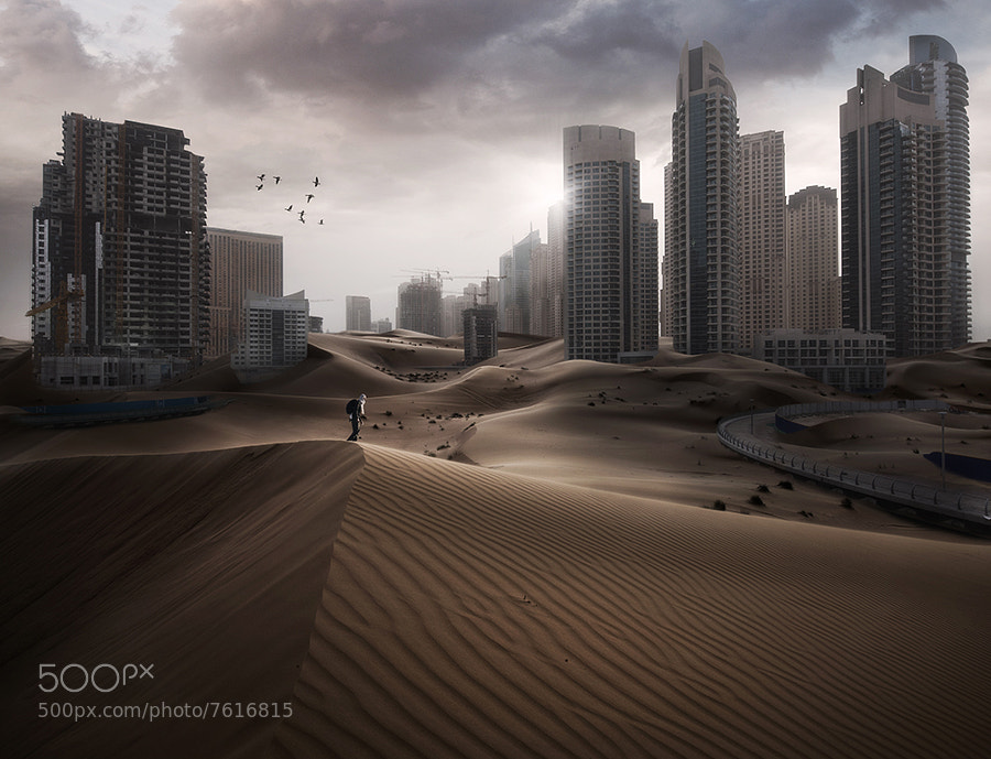 Dubai Marina and a desert shot from just outside Dubai, merged together.