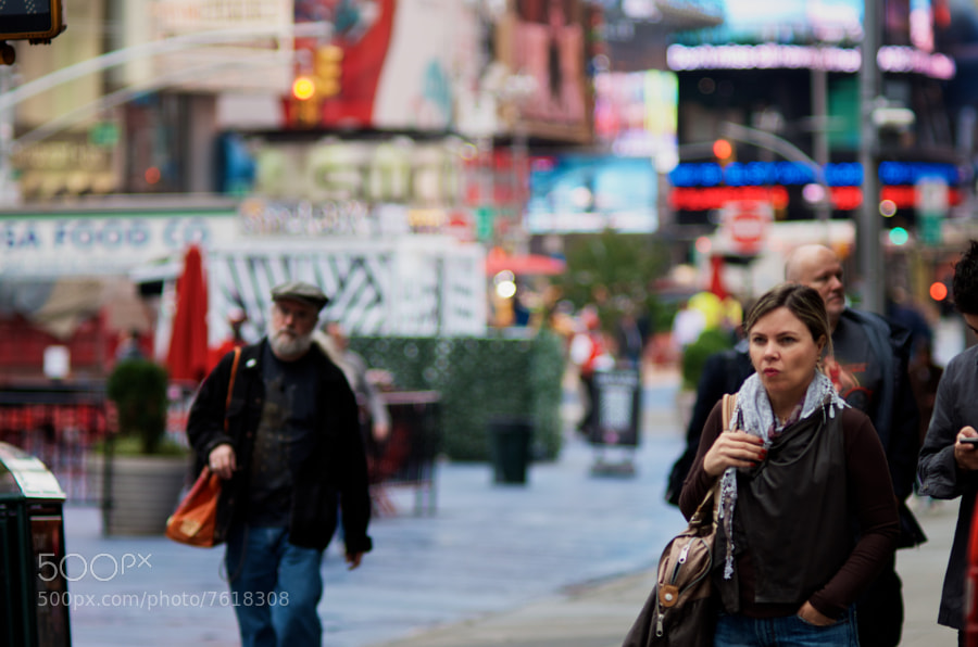 Rainy morning near time square, this lady looked pensive as she waited to cross 48th.