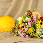Постер, плакат: The orange melon and autumn flowers
