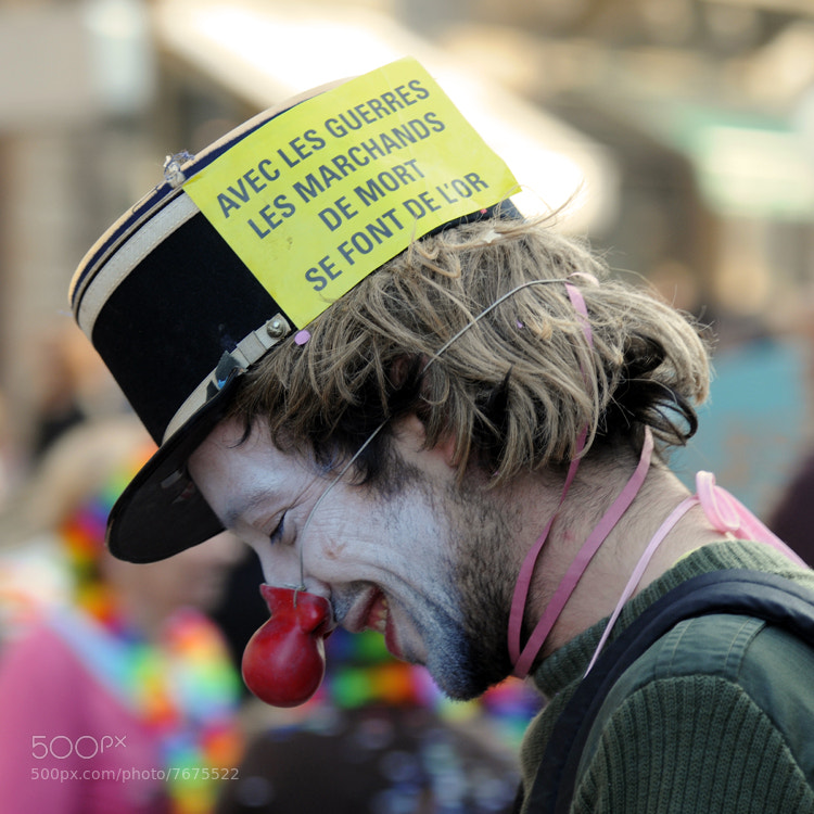 This clown had a serious message during the Bordeaux carnaval des deux rives.