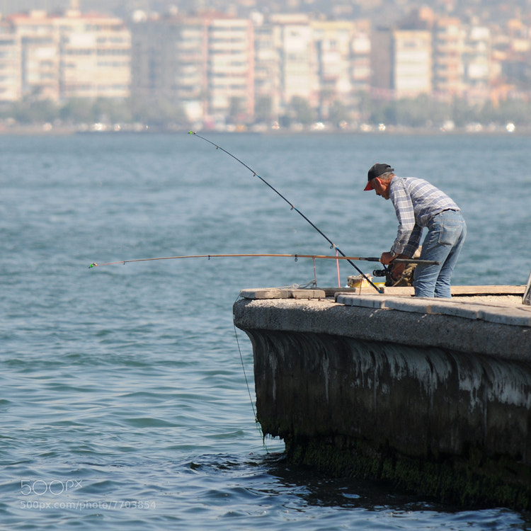 Setting up the fishing rods early in the morning (Izmir, Turkey).