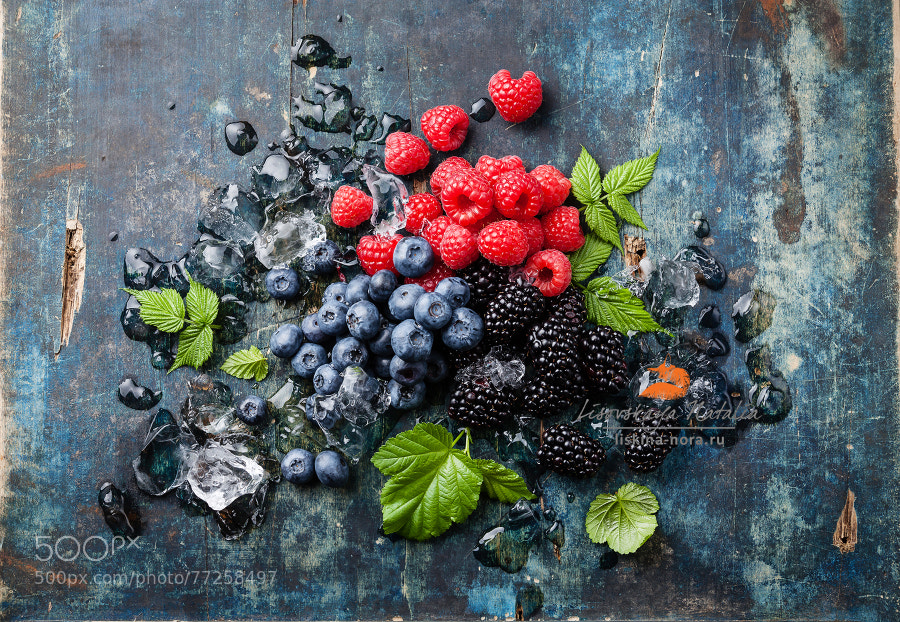 Mix of fresh berries with ice