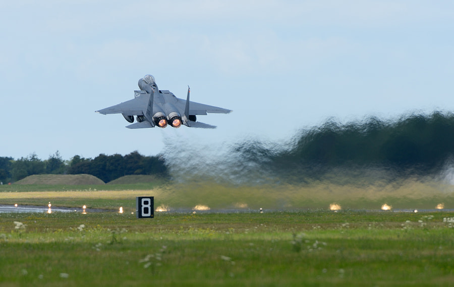 F15E Strike Eagle just after take off with quite some heat behind it from the very powerful jet engines.  Shot taken two weeks ago during the RIAT airshow on Fairford AFB in Gloucester, England.  Regards, Harry