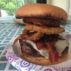 Постер, плакат: Pepper jack cheeseburger with bacon shoestring onion rings and Guinness BBQ sauce OC 3264x2448