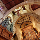 A quirky angle, depicting the altar, pipe organ and crucifix of St Peter's Anglican Cathedral in Adelaide.