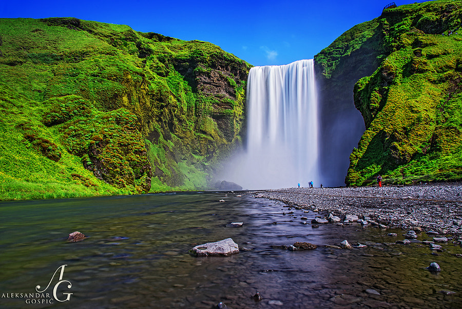 Skogafoss waterfall, 60 meters high exclamation point of Skoga river before she meets with the Atlantic Ocean