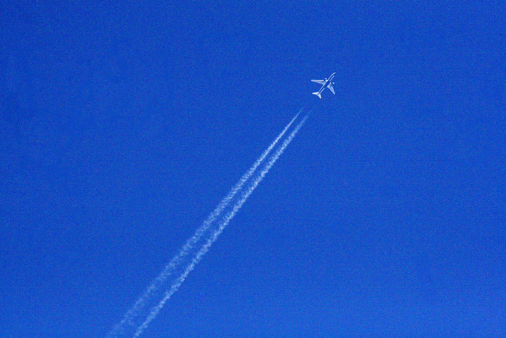 Photograph Untitled (Plane Pollution) by Owen Martin on 500px