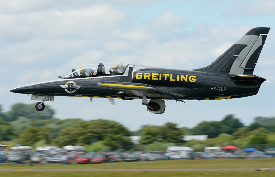 """This Breitling Jet Team L-39C Albatros aircraft is flown by Patrick Marchand, known as """"Gaston"""", enjoyed a career as a fighter pilot on Jaguar and Alpha Jet planes. He performed flight demonstrations over a five-year period as part of a pair of Jaguars, the """"Raffin Mikes"""". He has clocked up 5,500 flight hours.  Shot taken during the RIAT Airshow at Fairford AFB in Southwest England.  Regards and have a nice day,  Harry"""