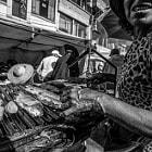 bolivia titikaka woman selling fish street photography