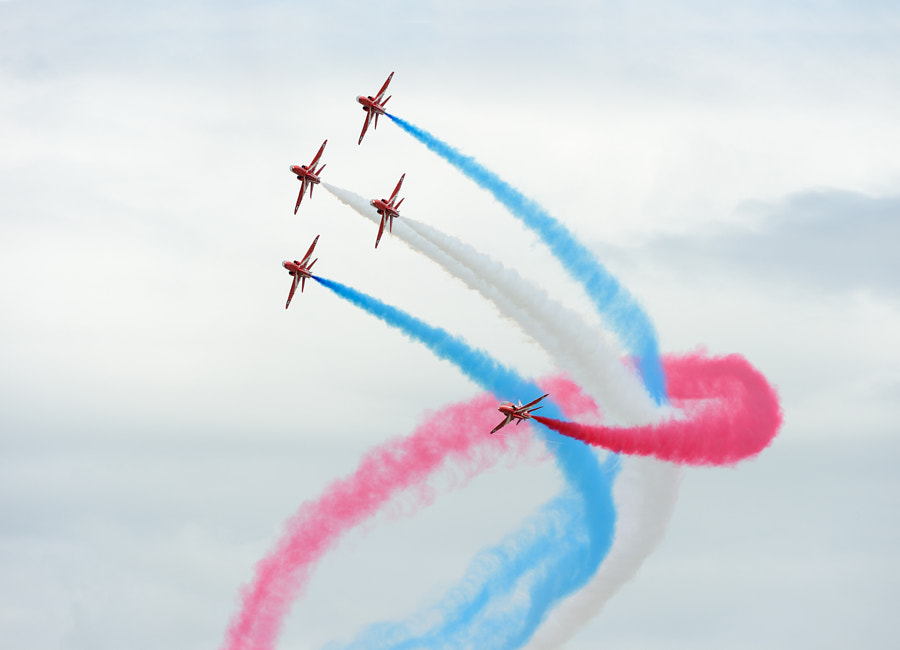 The Red Arrows celebrating their 50th Anniversary.  Shot taken during the RIAT Air Show at Fairford AFB.  Regards and have a nice day,  Harry