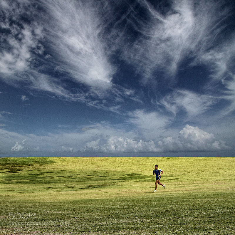 Photograph Running in the Morning by Carlos Gotay on 500px