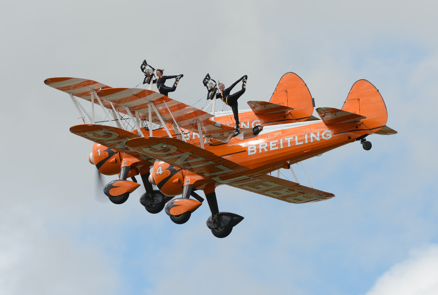 The wonderful ladies of the Breitling AeroSuperBatics Wingwalkers team.  Sot taken during the RIAT Airshow at Fairford AFB in Gloustershire, England.  For more information http://www.aerosuperbatics.com/  Regards and have a nice weekend,  Harry