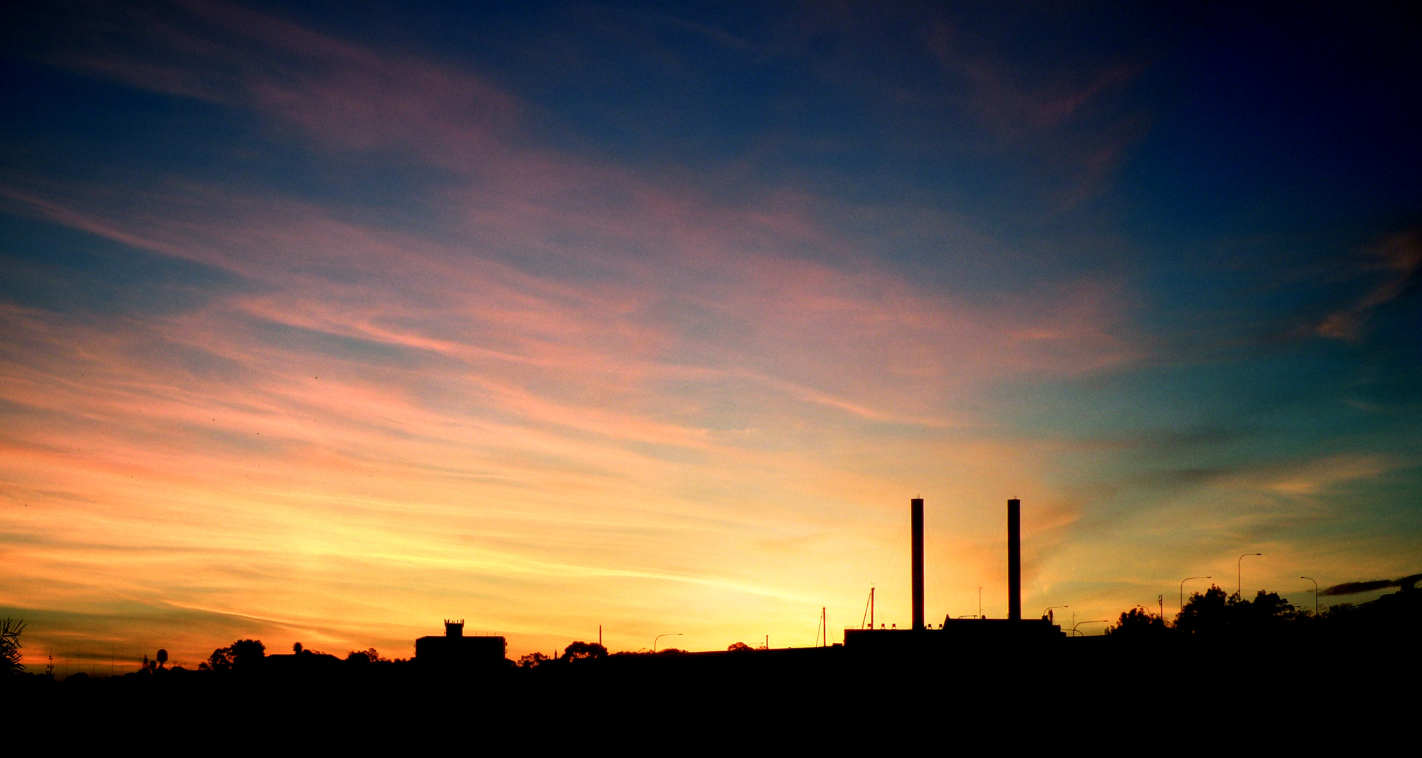 Photograph Sun Sets on Industry by Tim Hunter on 500px