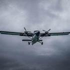 Постер, плакат: A small Twin Otter Plane approaching