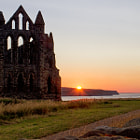 Постер, плакат: Whitby Abbey at sunset