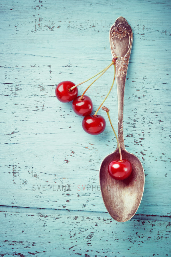 Vintage spoon and cherry berries on old wooden board by ImagineIsle on 500px.com