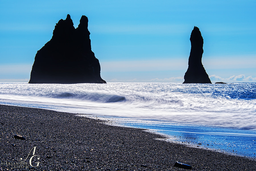 Morning on the volcanic beach Reynisfajara. Days like this are very rare in Iceland, you even feel the call of the Atlantic to swim, but after dipping toes into the sea of 10°C that desire passes fairly quickly, but that obviously doesn't bother the Reynisdrangar cliffs