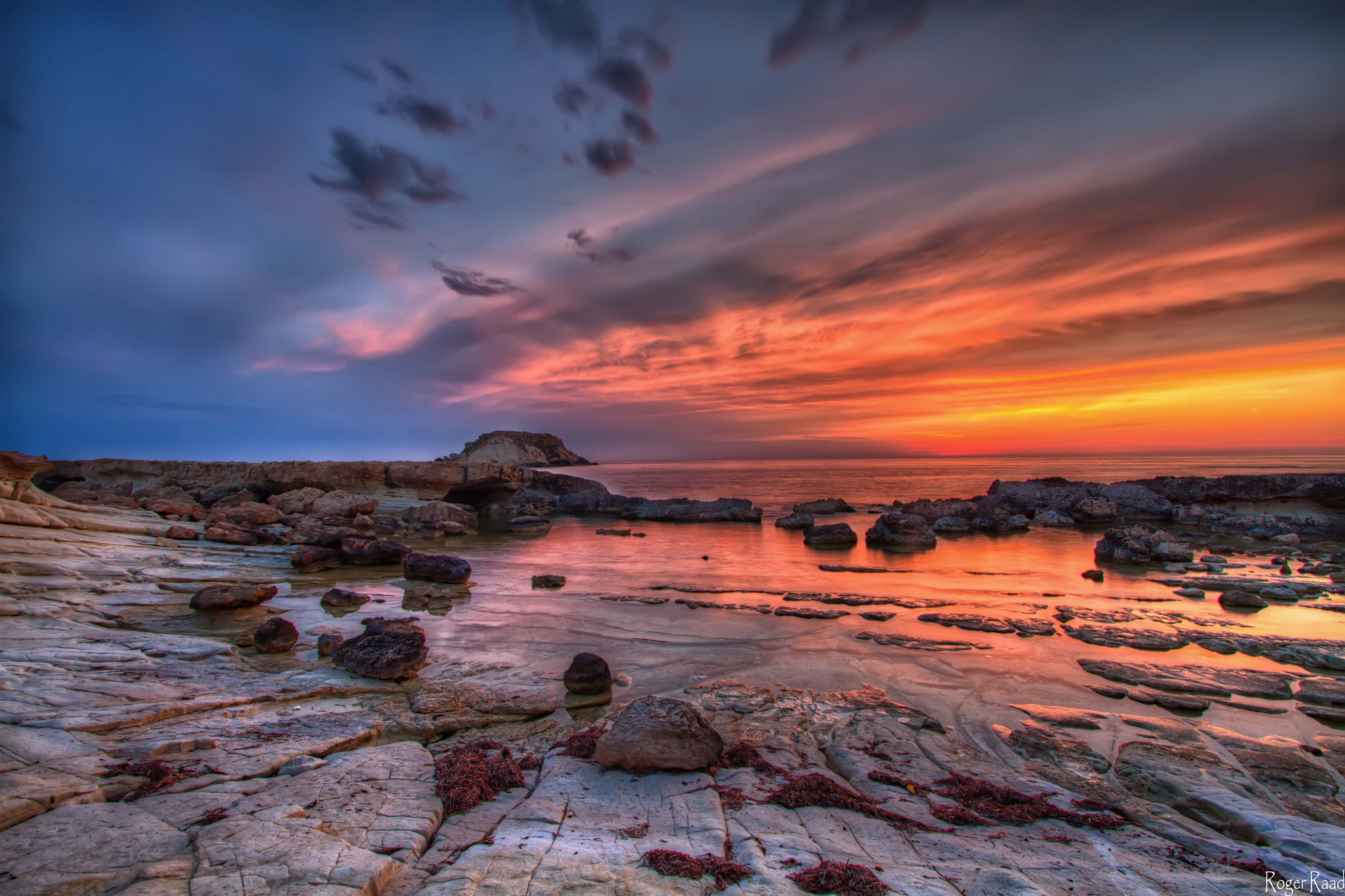 Photograph On The Rocks  by Roger Raad on 500px
