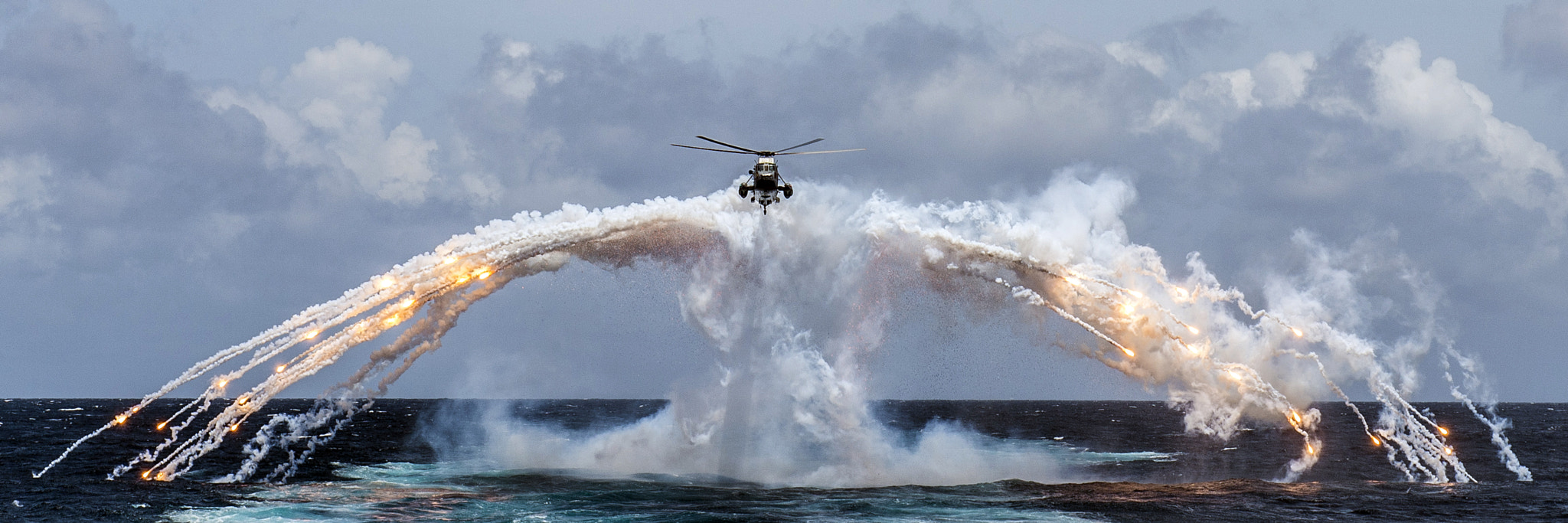 Photograph Helicopter deploying her flares by Michael  Bastien  on 500px