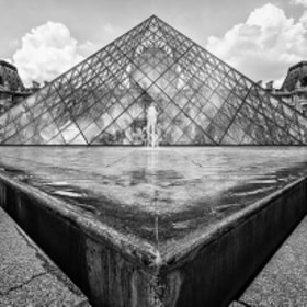 Close-up of a fountain pool next to the main Pyramid outside the Louvre, Paris, France