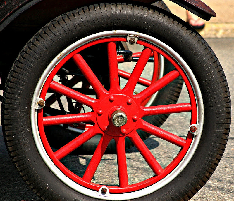 Photograph Red Wheel Rolling by Greg Maney on 500px