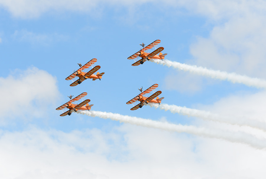 The wonderful ladies of the Breitling AeroSuperBatics Wingwalkers team.  Sot taken during the RIAT Airshow at Fairford AFB in Gloustershire, England.  For more information http://www.aerosuperbatics.com/  Regards and have a nice day,  Harry