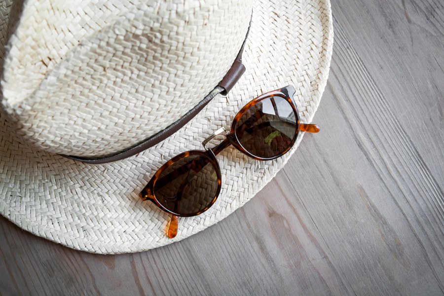 Straw hat and sunglasses by Eduardo Lopez on 500px.com