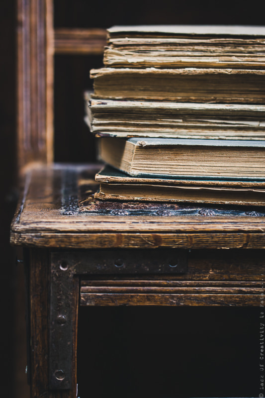 Vintage books on old wooden chair.