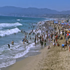 This photo was shot off the Santa Monica Pier on a very busy beach day in Santa Monica. Thousands of people enjoying the beach on this Labor Day weekend in Santa Monica, California.
