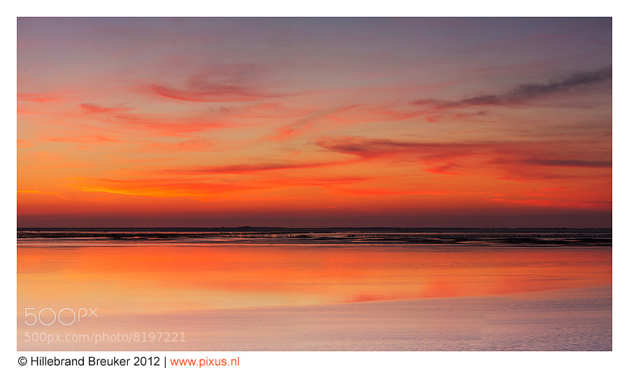 This is a photo of the Sunset of the Wadden Sea. The Wadden Sea is a tidal sea that is at the coast line of Netherlands, Denmark and Germany.