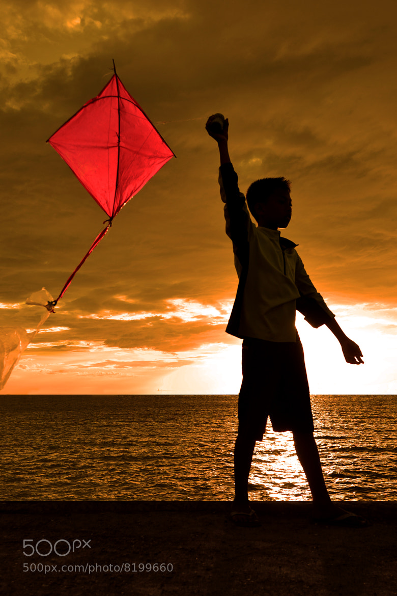 Photograph A Boy and a Kite by Wilfredo Lumagbas Jr. on 500px