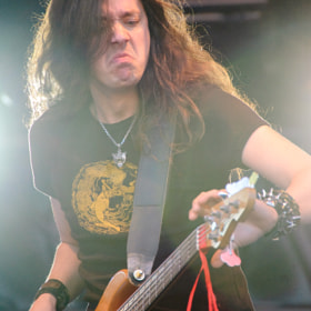 Bassist Lauri Porra of Stratovarius performing.