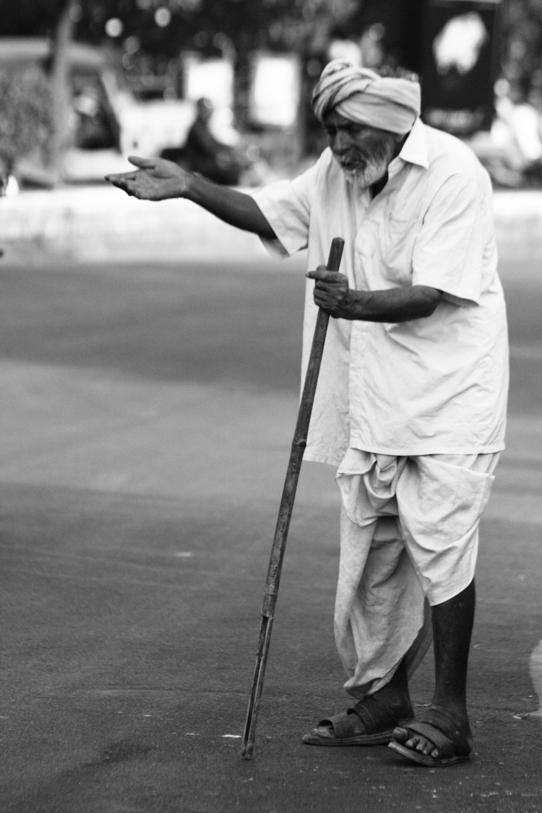 Photograph At His Age Begging for Alms.. All he Actually needs is a Few Helping Arms.. He Wouldn't Need anythin by Robins Mathew on 500px