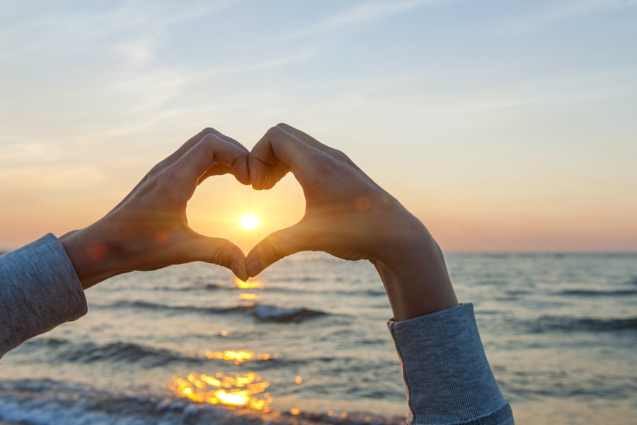 Photograph Hands in heart shape framing sun by Elena Elisseeva on 500px
