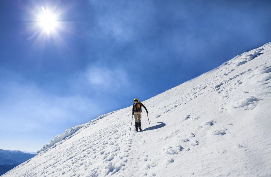 Climber on the way to the top of an active volcano Villarica in by Maciej Bledowski on 500px.com
